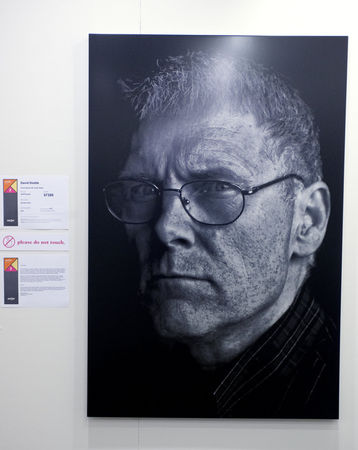 ArtPrize entry by Grand Rapids resident David Dodde is a portrait of his father who passed in 2013. The artist used silver and his father's ashes to create the image that was screen printed by hand. The piece can be seen displayed at the Women's City Club. (Emily Rose Bennett | MLive.com)