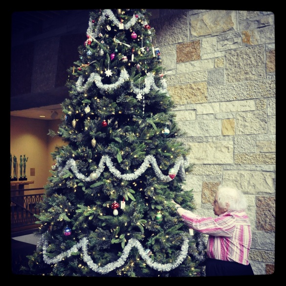 Lena Meijer helps decorate the German tree.